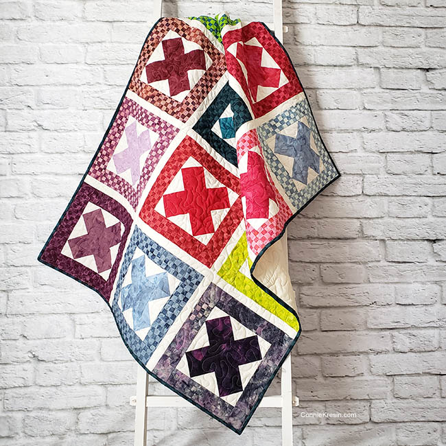 Ready Set Go Baby Quilt on ladder