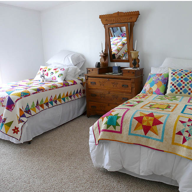 Twin beds with quilts