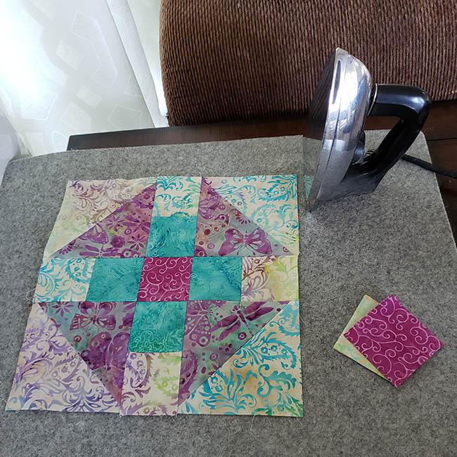 Luna quilt block on wool ironing mat for Island Batik quilt