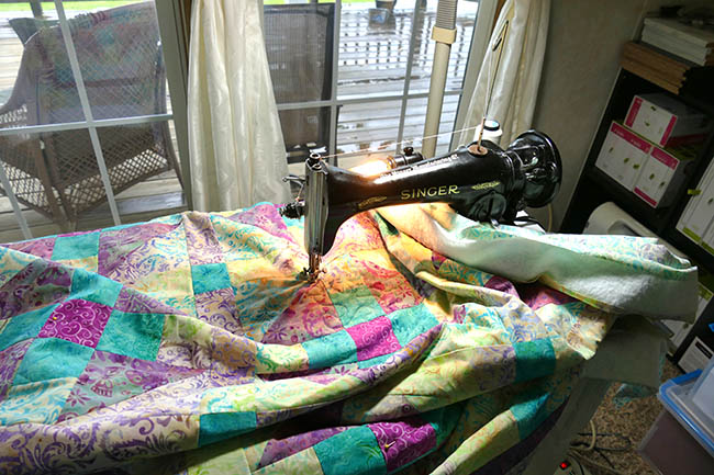 Quilting on my vintage 15-91 Singer sewing machine by the river