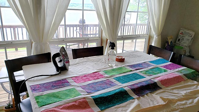 Ironing board for quilts on kitchen table