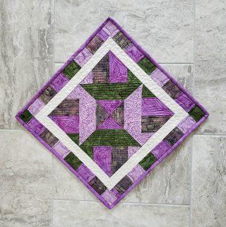 Artsy Fartsy Hidden Wells quilt project in batiks