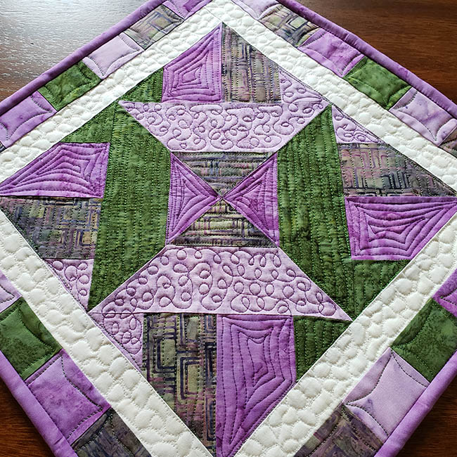 Artsy Fartsy Hidden Wells quilt with Aurifil freemotion quilting