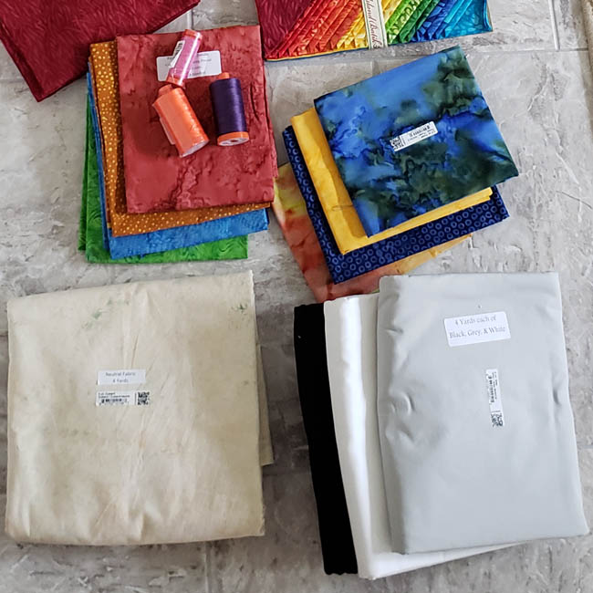 Island Batik goodies in Ambassador box solids and neutral fabric