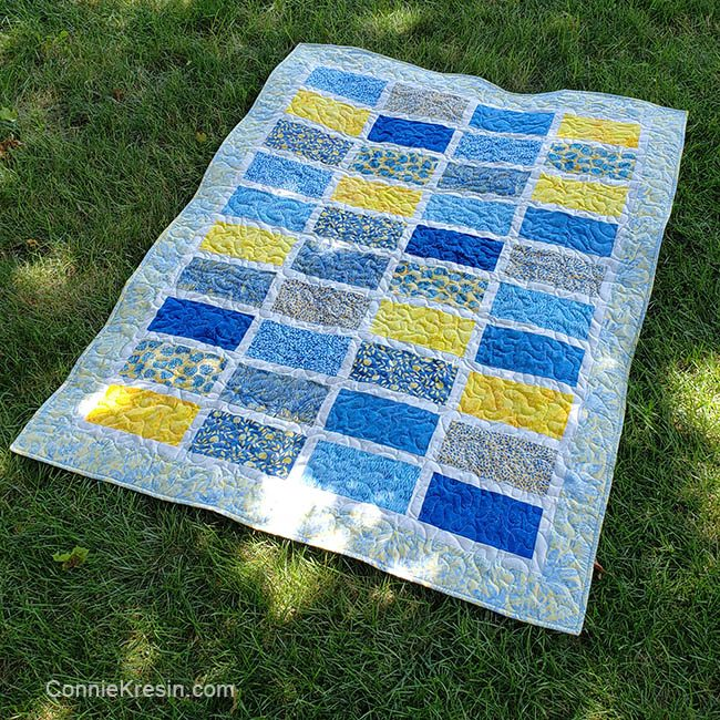 Sparkles quilt pattern on the grass made with Sunny Side Up batik collection