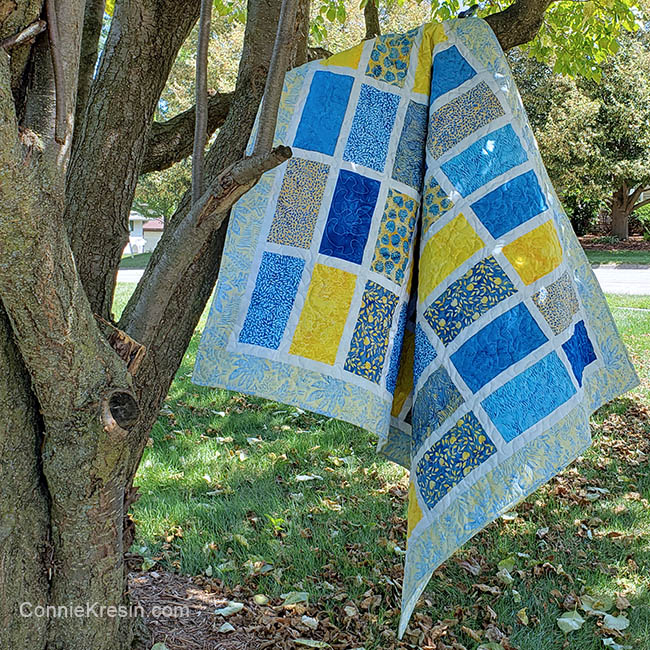 Sparkles quilt pattern in tree made with Sunny Side Up batik collection