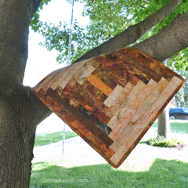Log cabin placemat tutorial hanging in tree