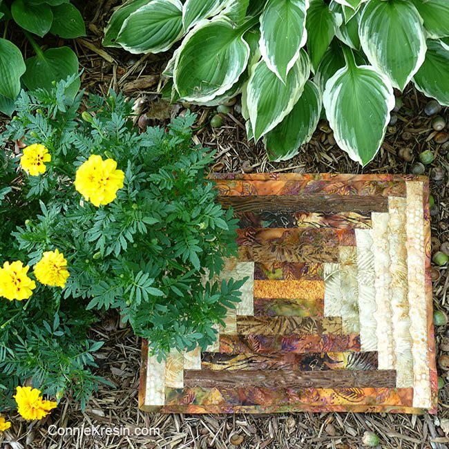 Logcabin placemat tutorial with marigolds in garden