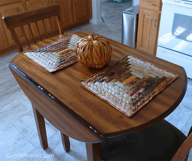 Quilted Log Cabin placemats on kitchen table