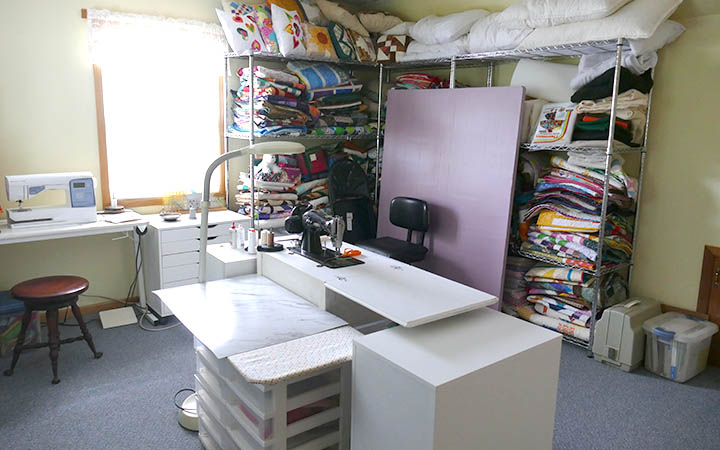 Quilt Studio setup upstairs with Ikea drawers and design wall