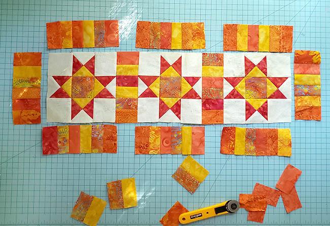 Ohio Star Table Runner in fiery orange Tutorial adding sashing
