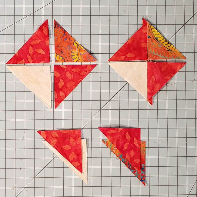 Ohio Star Table Runner in fiery orange Tutorial cutting quarter square triangles