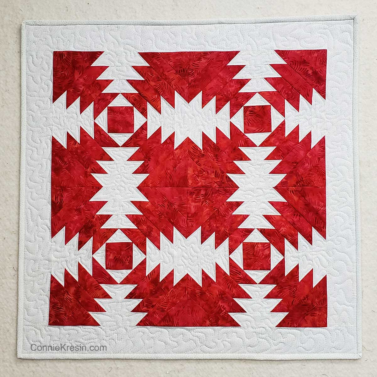 Fiery Pineapple batik wall hanging made with AccuQuilt cutter and die