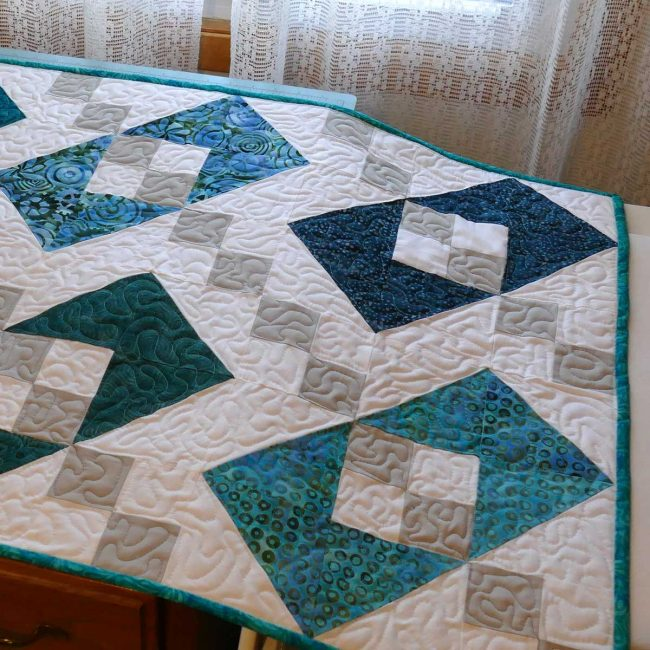 Close up of quilt showing the missed quilting