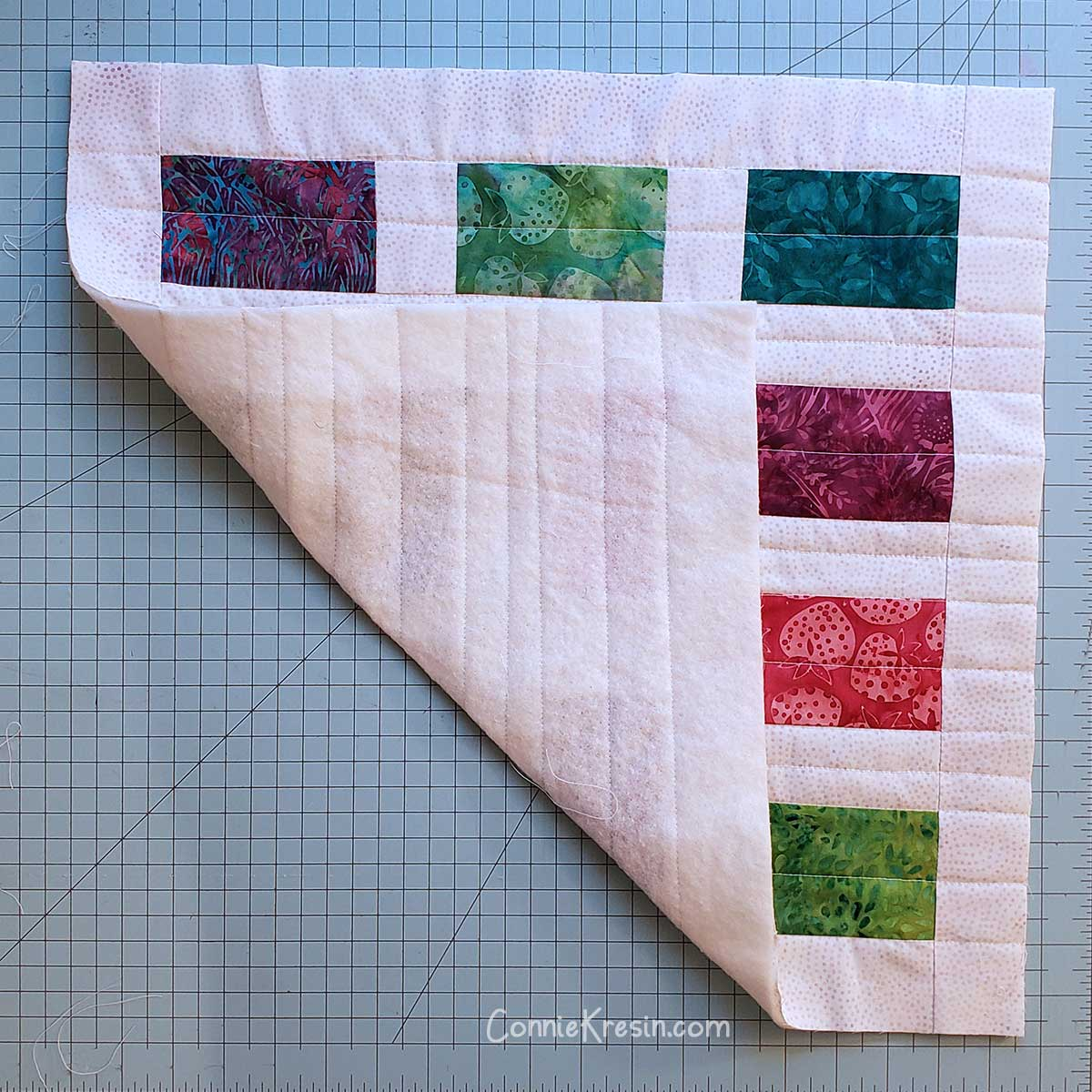 Back of quilted pillow