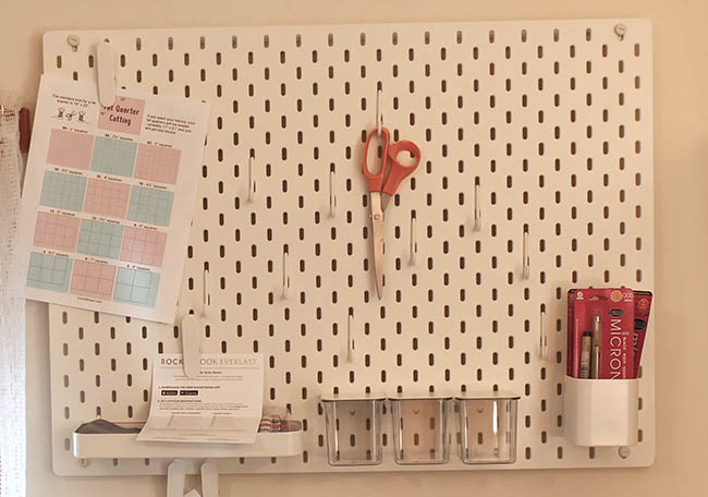 Sewing room Ikea pegboard shelves