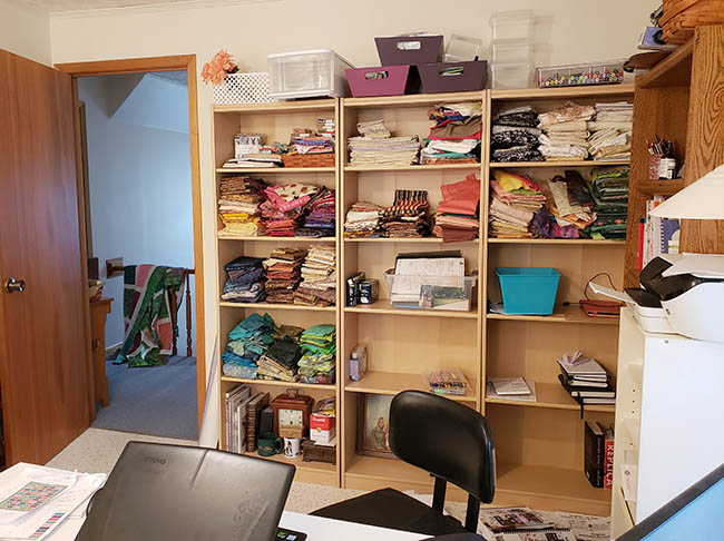 Sewing room lighting with bookcases of fabric