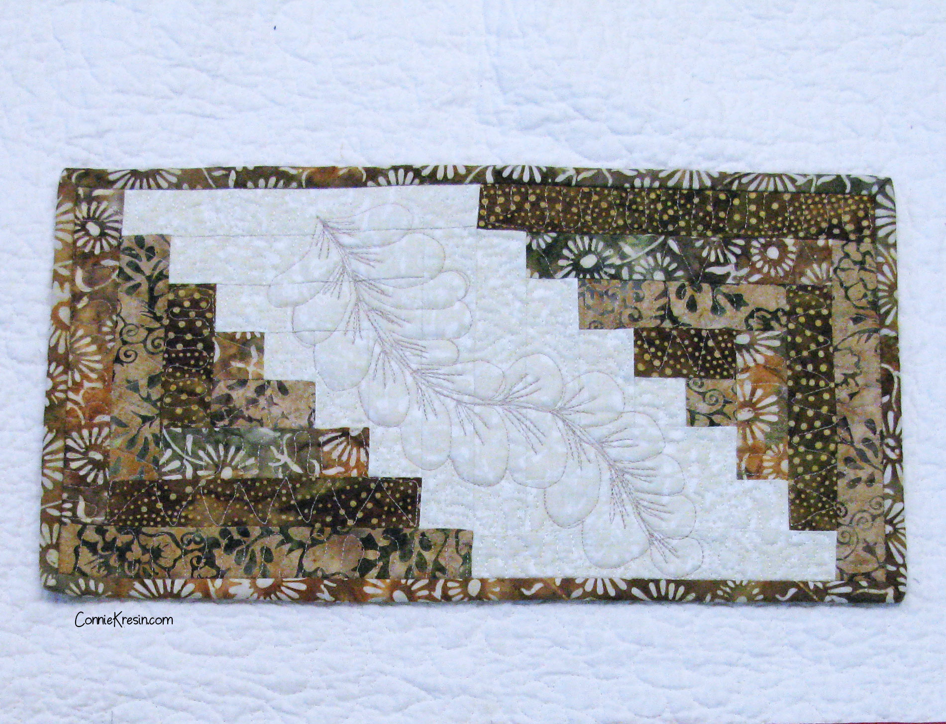 Mini feather quilted table runner in browns