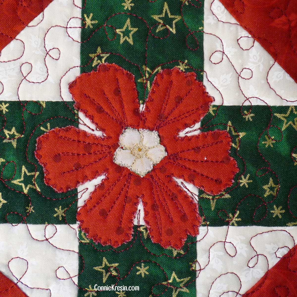 Closeup of the applique and quilting on the Christmas mug rug