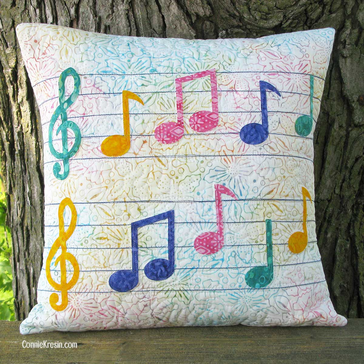 Applique Musical Pillow on deck rail