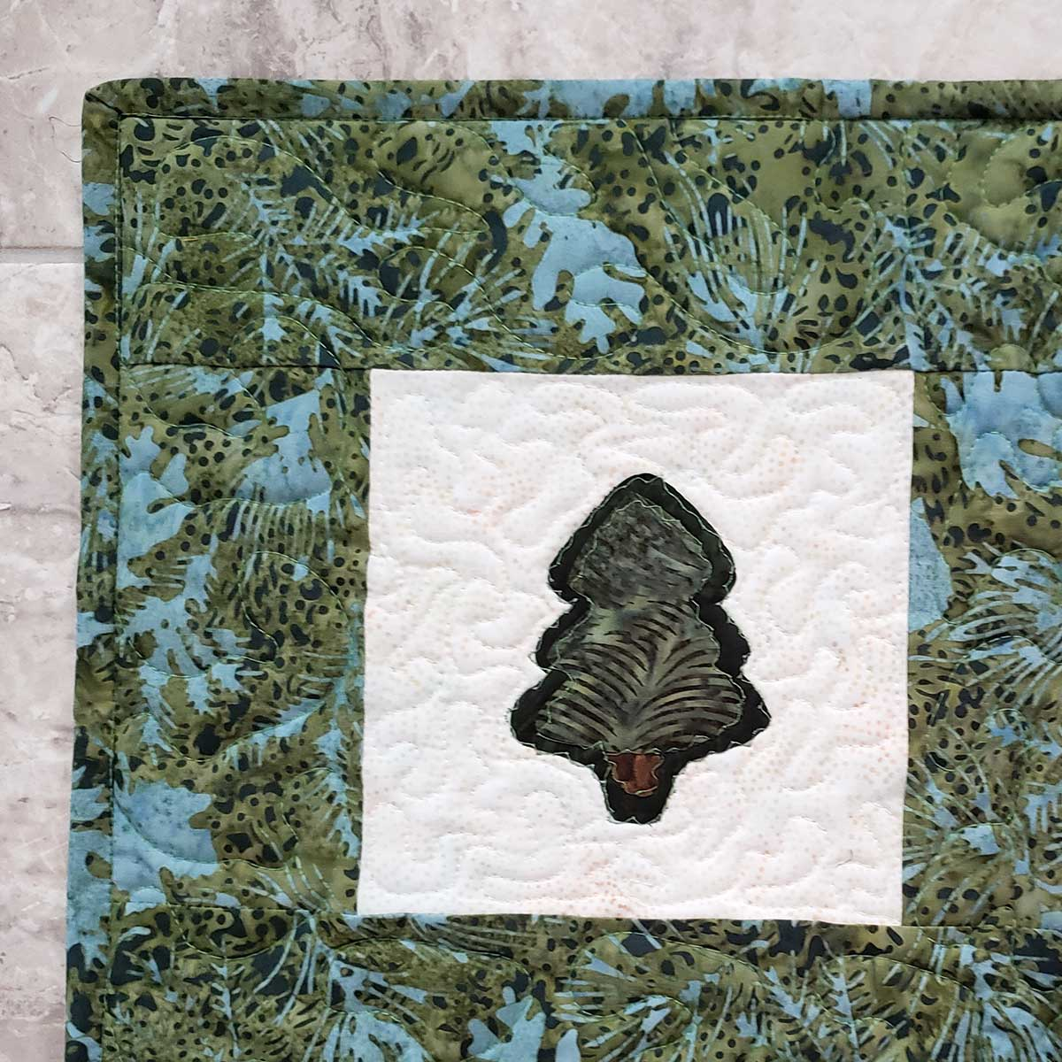 Free-motion quilt and add binding