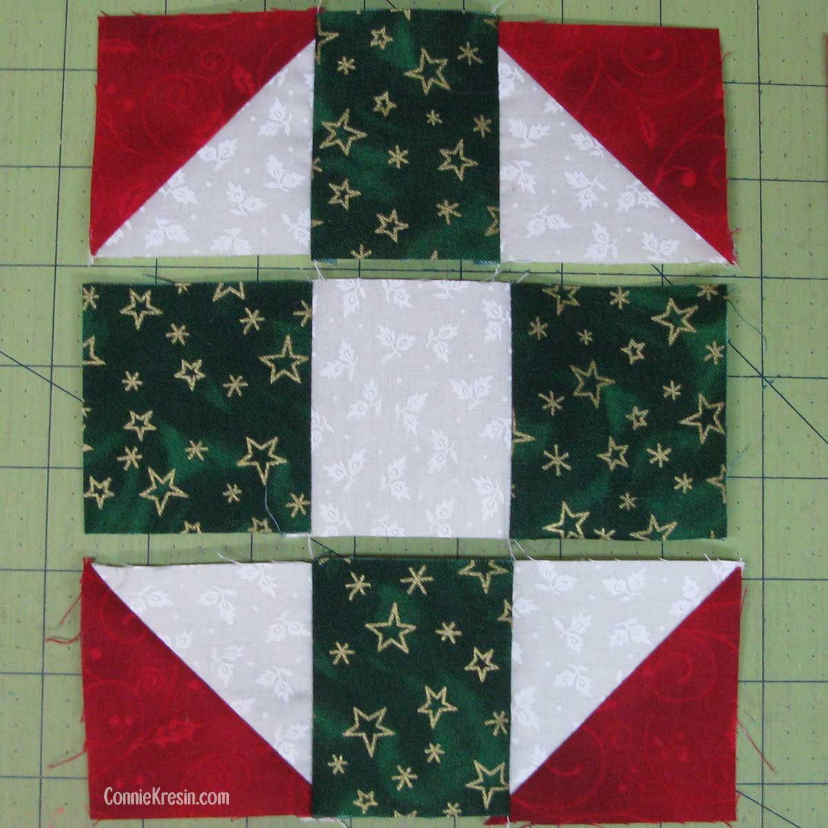 Piece the rows of the quilted Christmas mug rug together