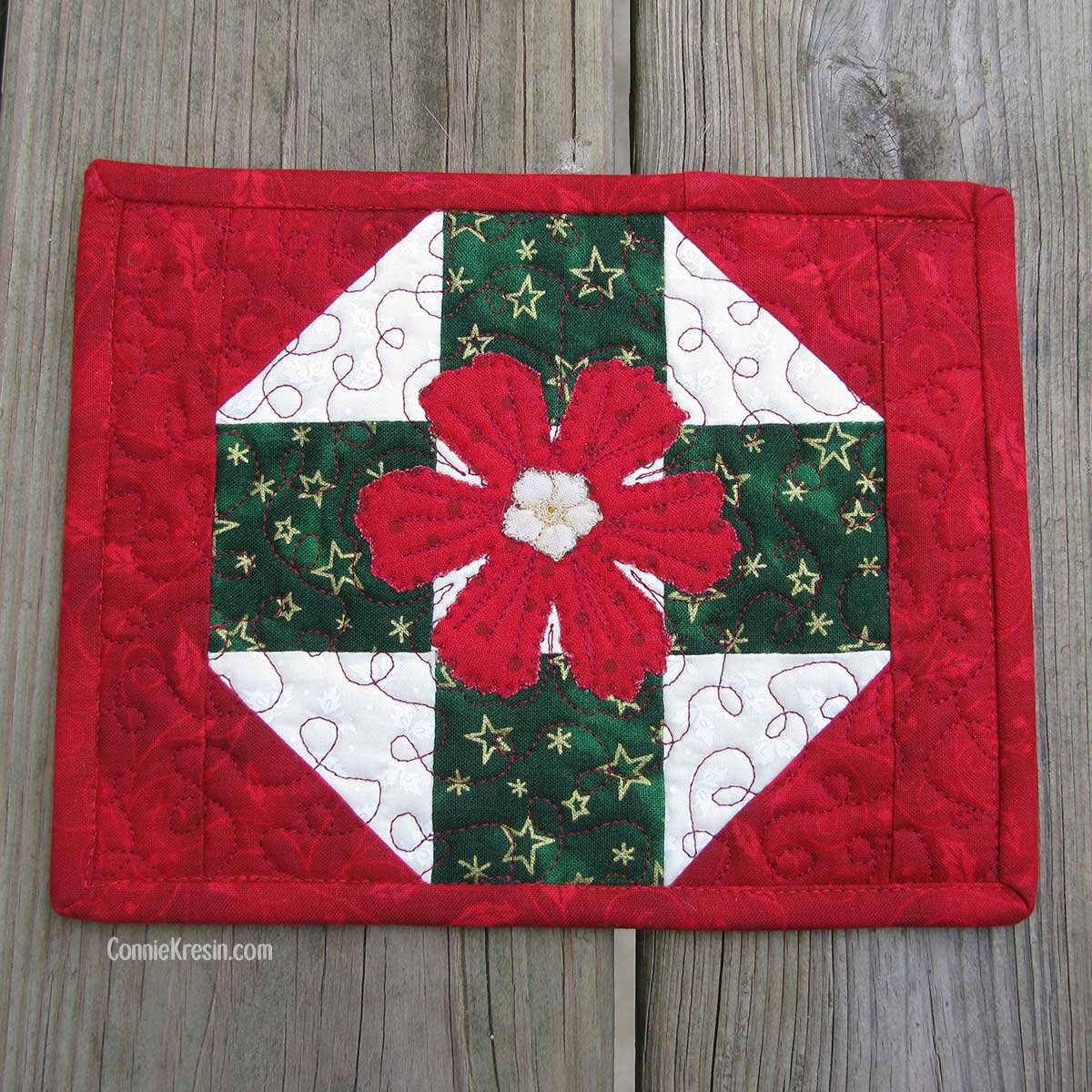 Quilted Christmas Mug Rug with applique flower