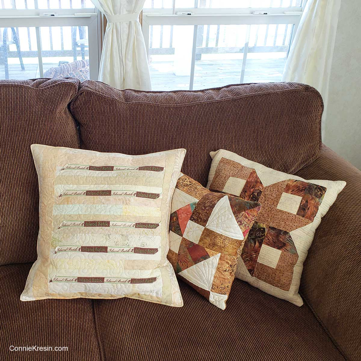 Quilted pillows including the label pillow on couch