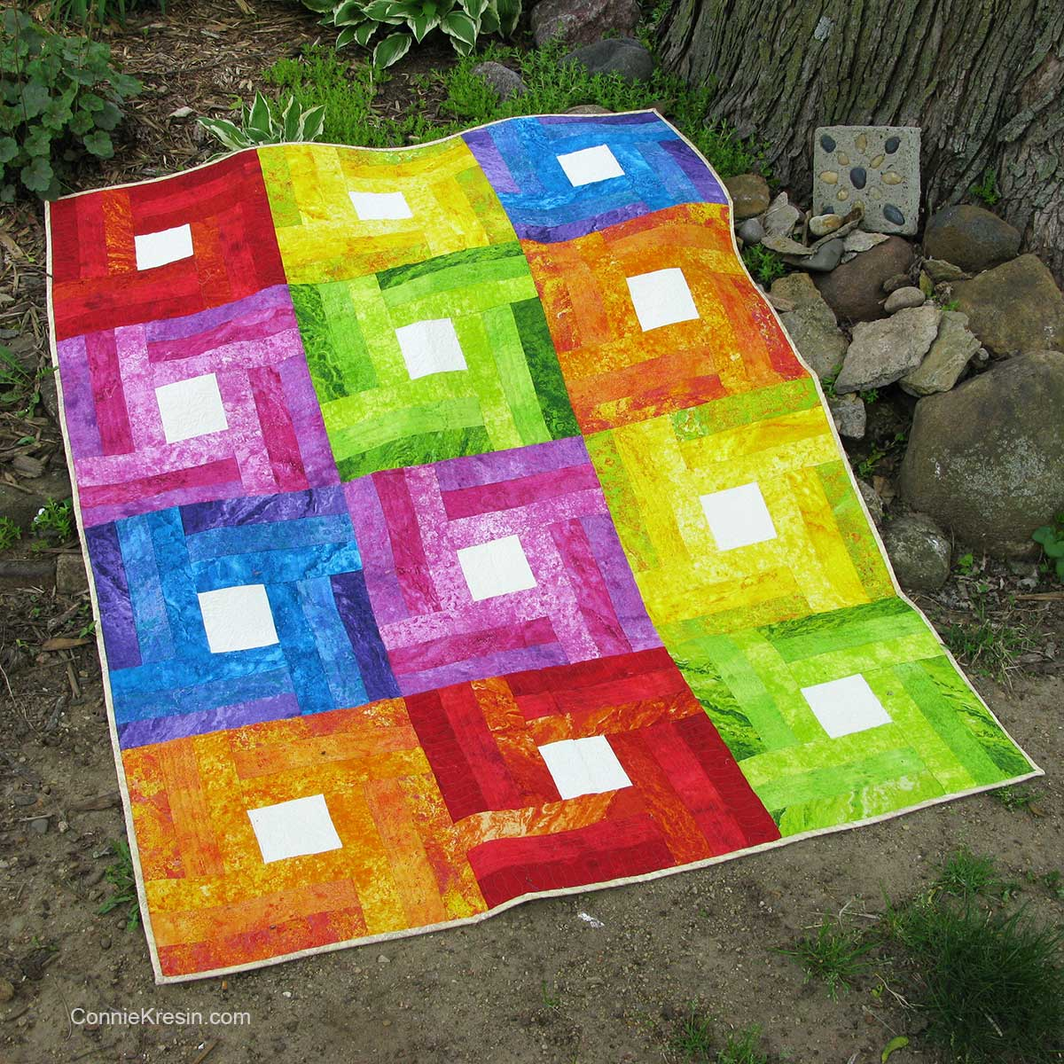 Rainbow Baby Quilt in the grass