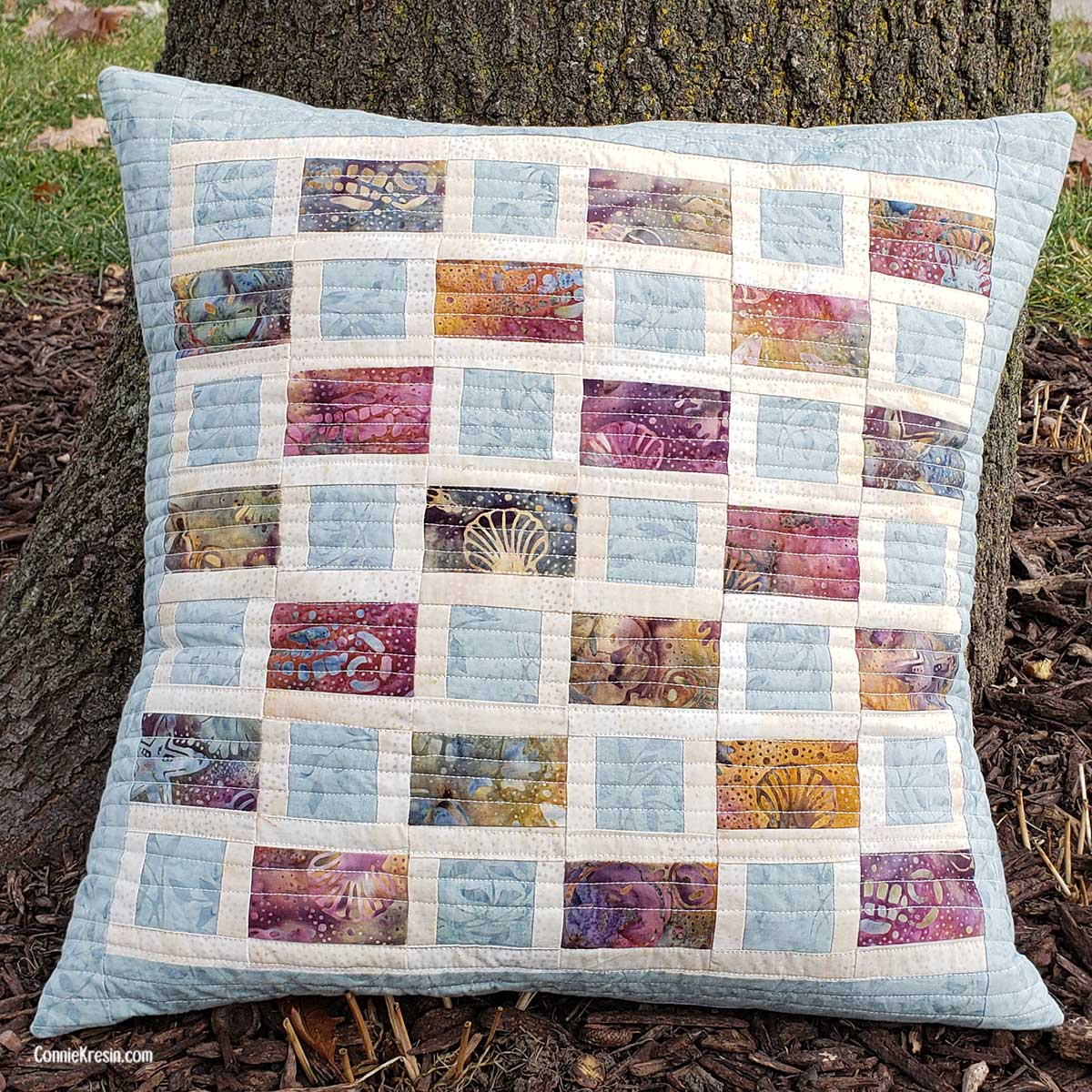 Brick Road Quilted and straight stitched pillow