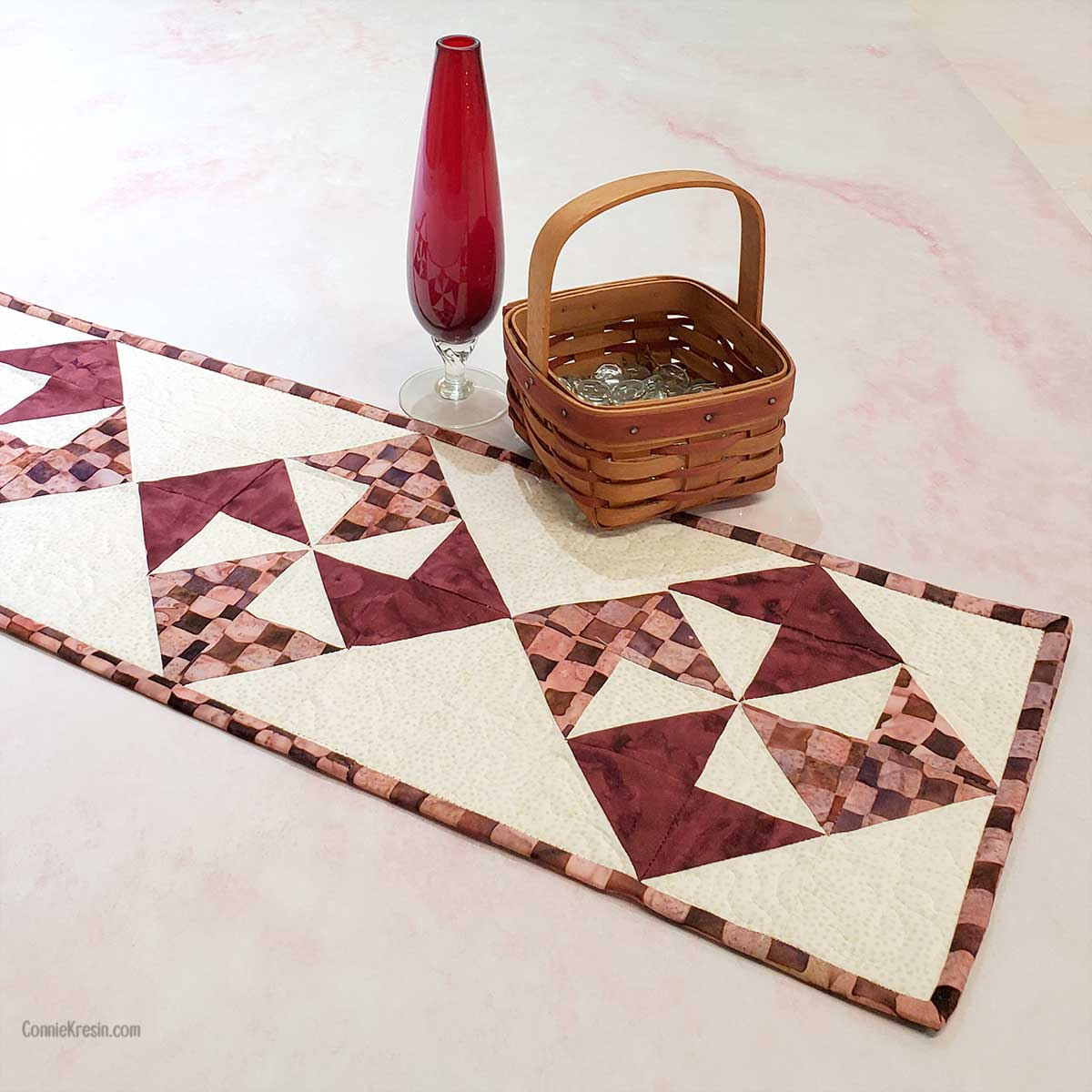 Pinwheel Table runner with vase and basket
