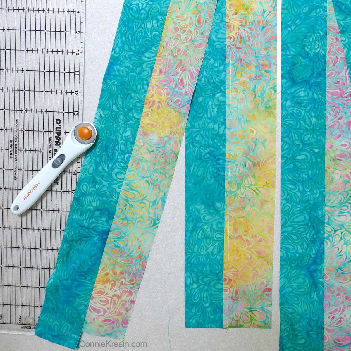 Sew the fabric strips together