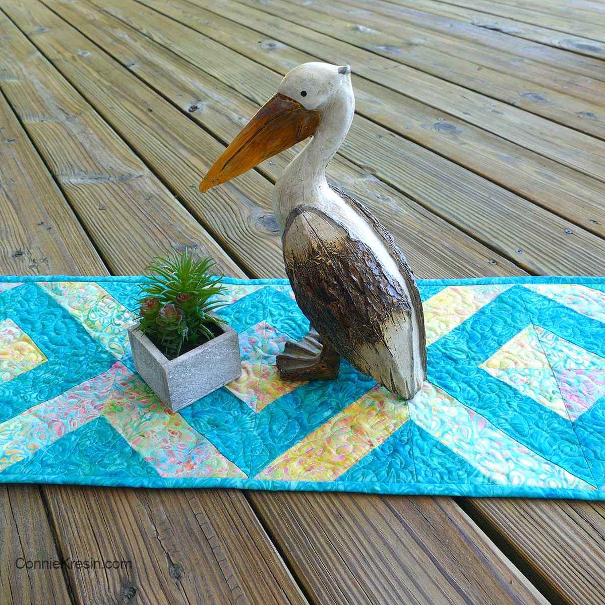 45-degree strip tube table runner on deck with pelican