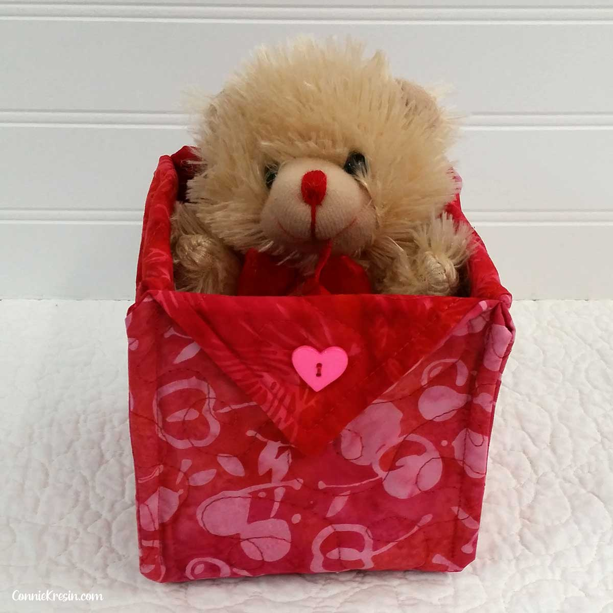 Valentine fabric basket with teddy bear in it