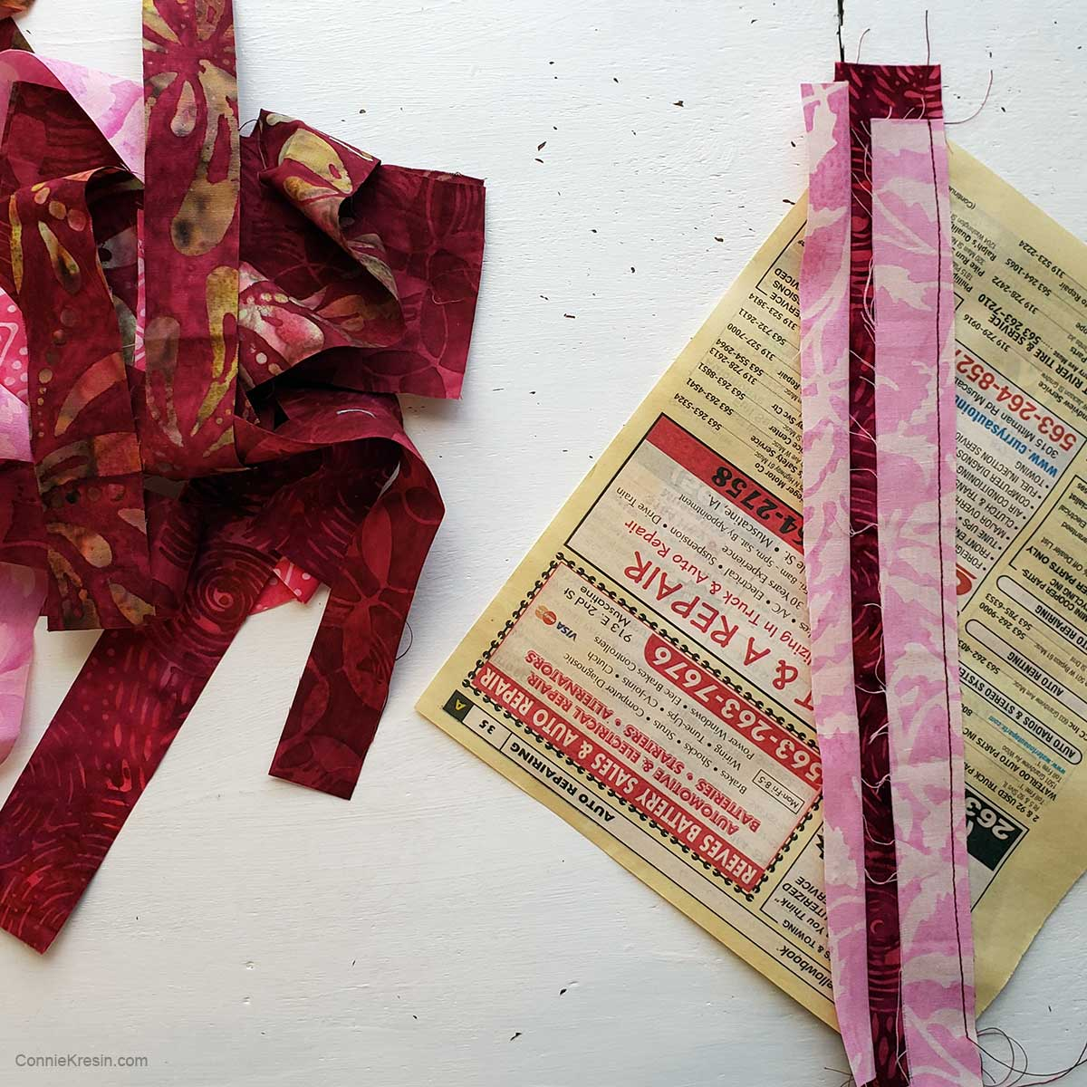 strip piecing the mug rug on a telephone book page