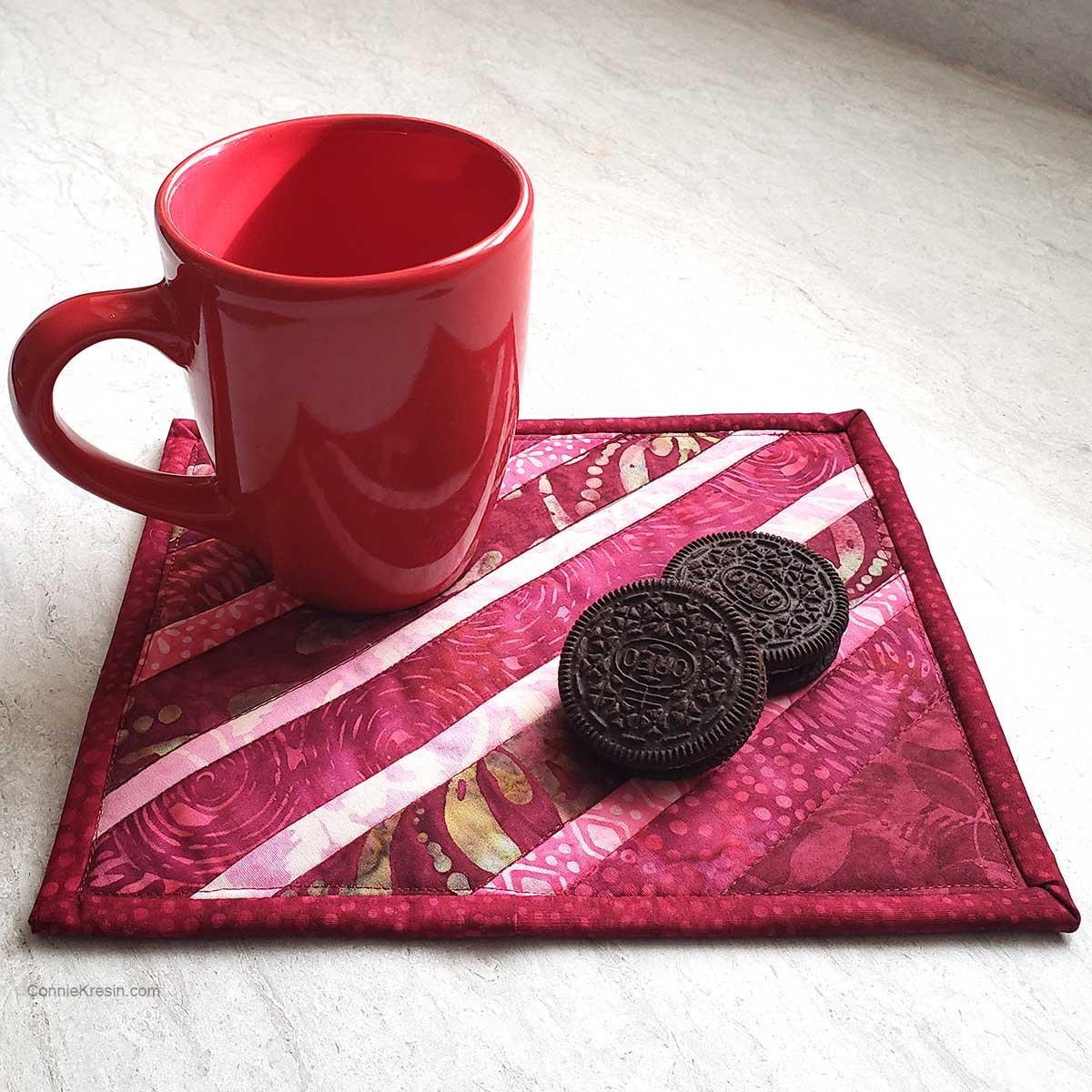 Wine batik mug rug strip pieced with cookies