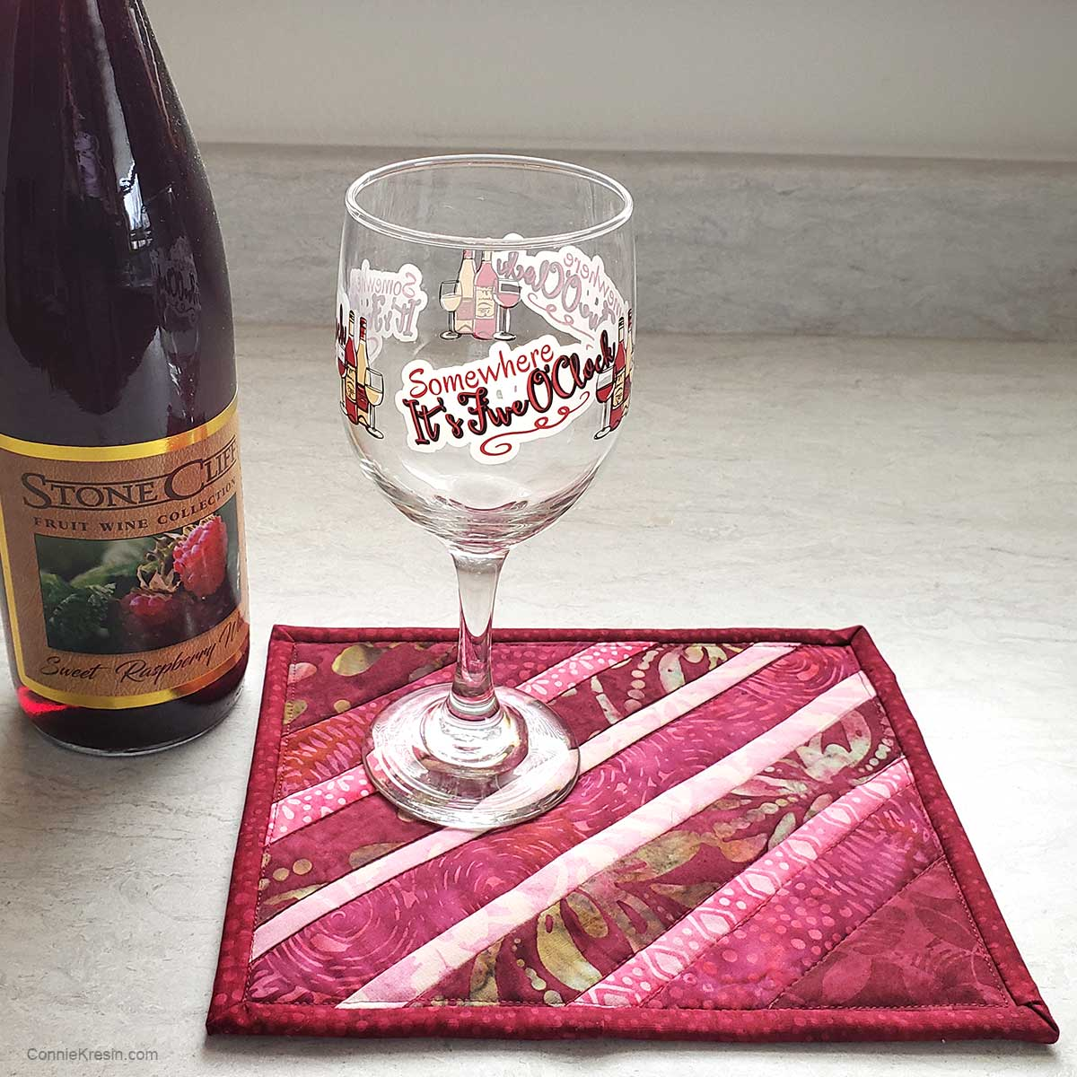 Mug rug with a wine glass and bottle of wine