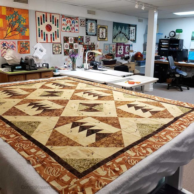 Tassel quilt top on cutting table
