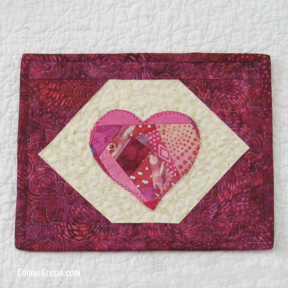 Mug rug with crazy pieced heart