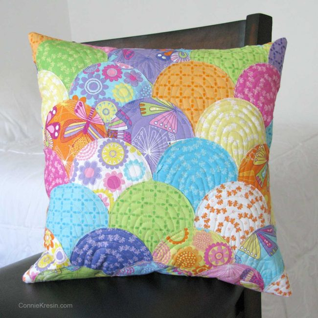 Applique Clamshell pillow on chair