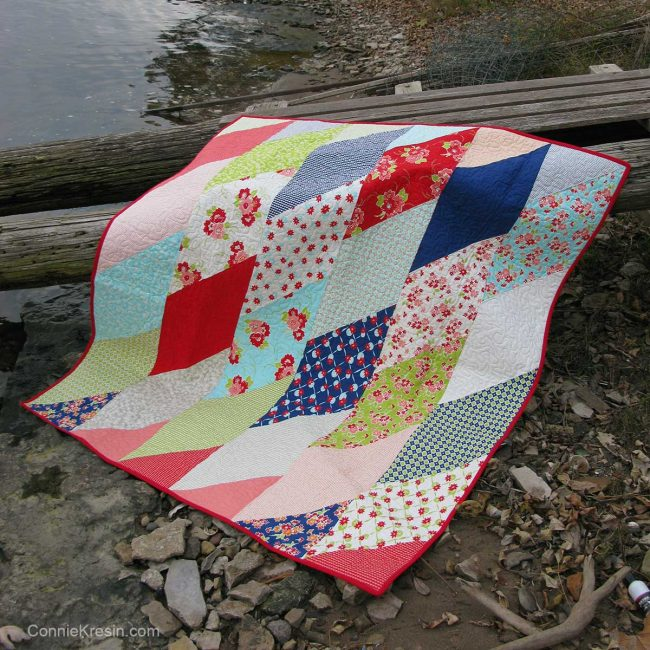 Quilt on telephone pole by the river