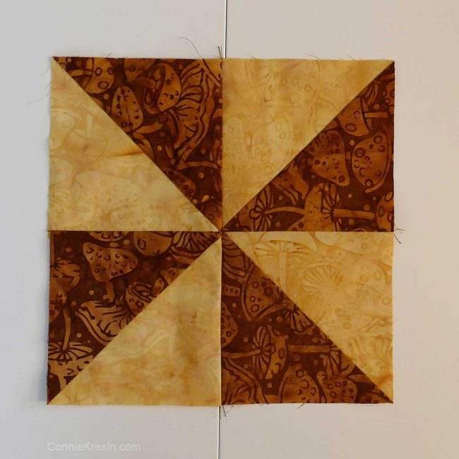 Half square triangle blocks made into a pinwheel block