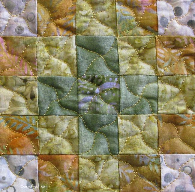 Closeup of quilting on mug rug
