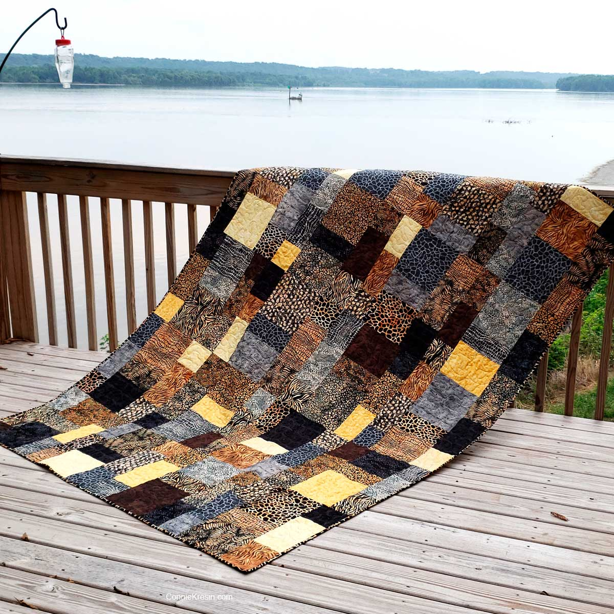 Stacks quilt shown in brown and tan batiks