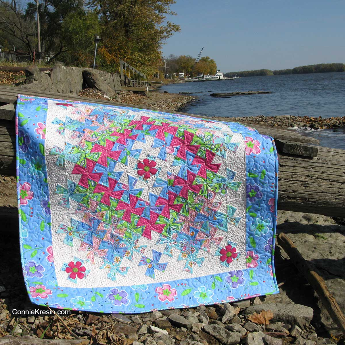 Worldly lit twister appliqued baby quilt