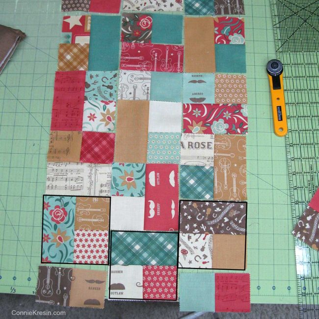 laying out the charm blocks for the runner