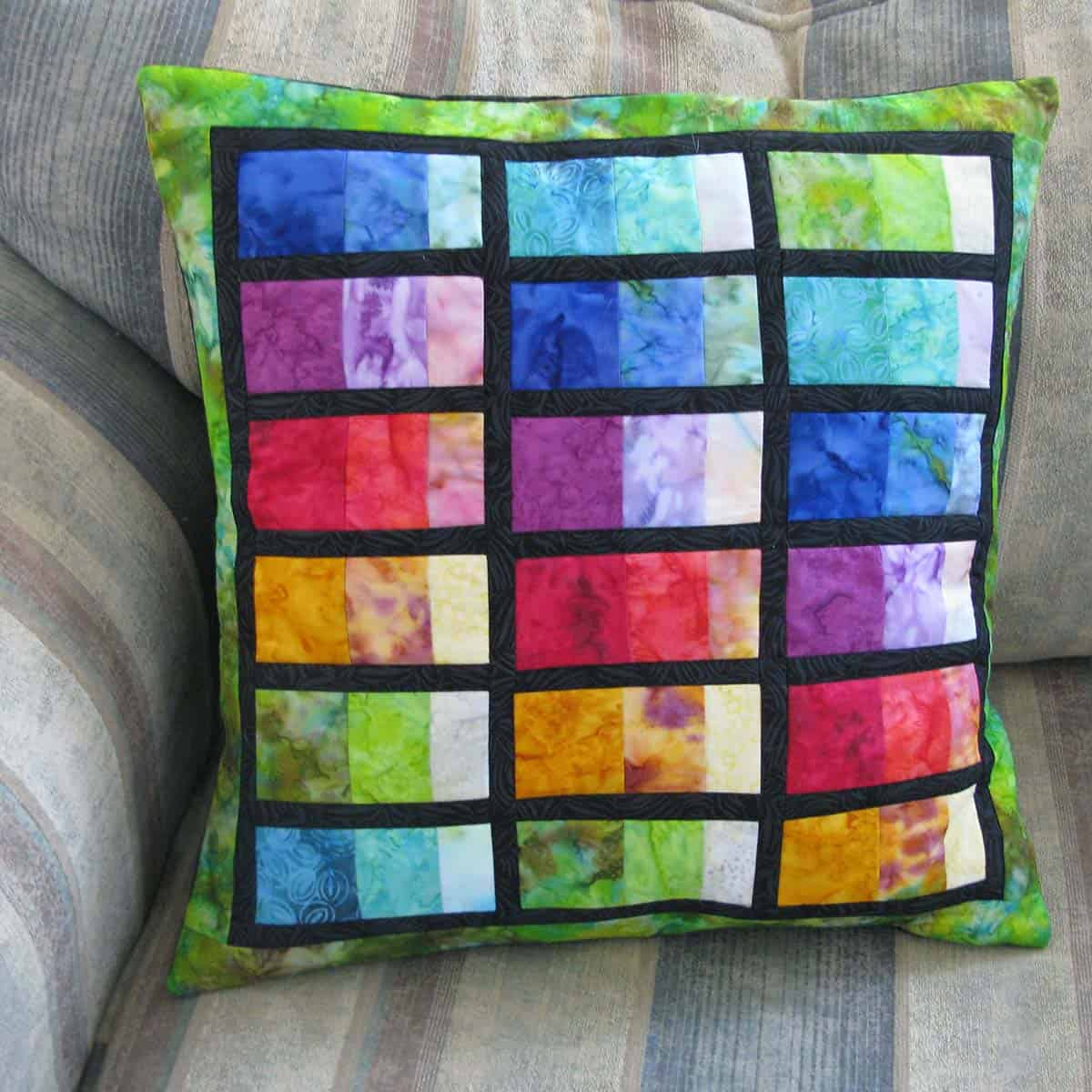 Stacked Rainbow pillow on chair