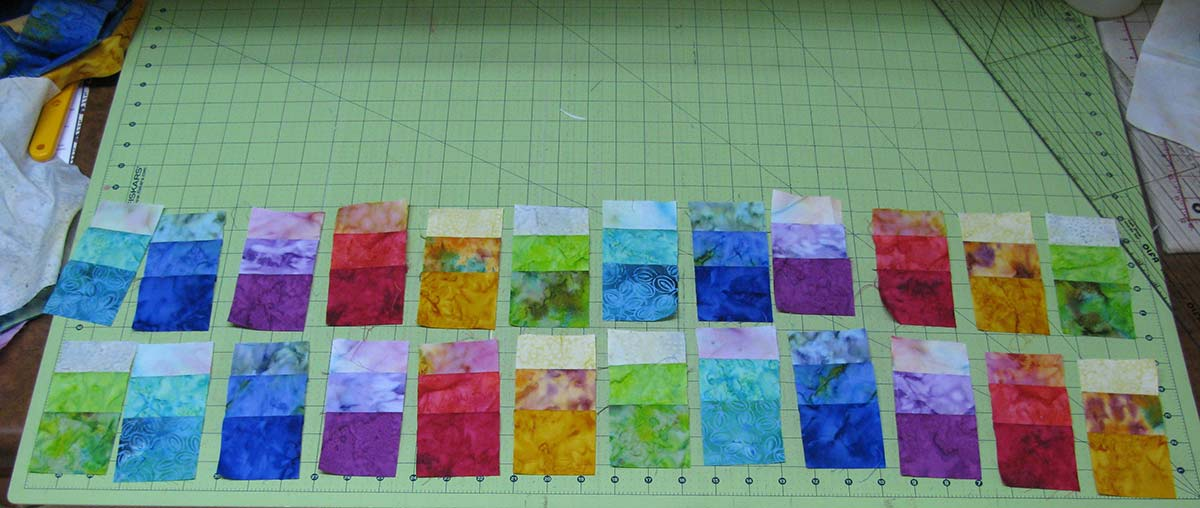 Cutting fabric pieces for the Rainbow pillow