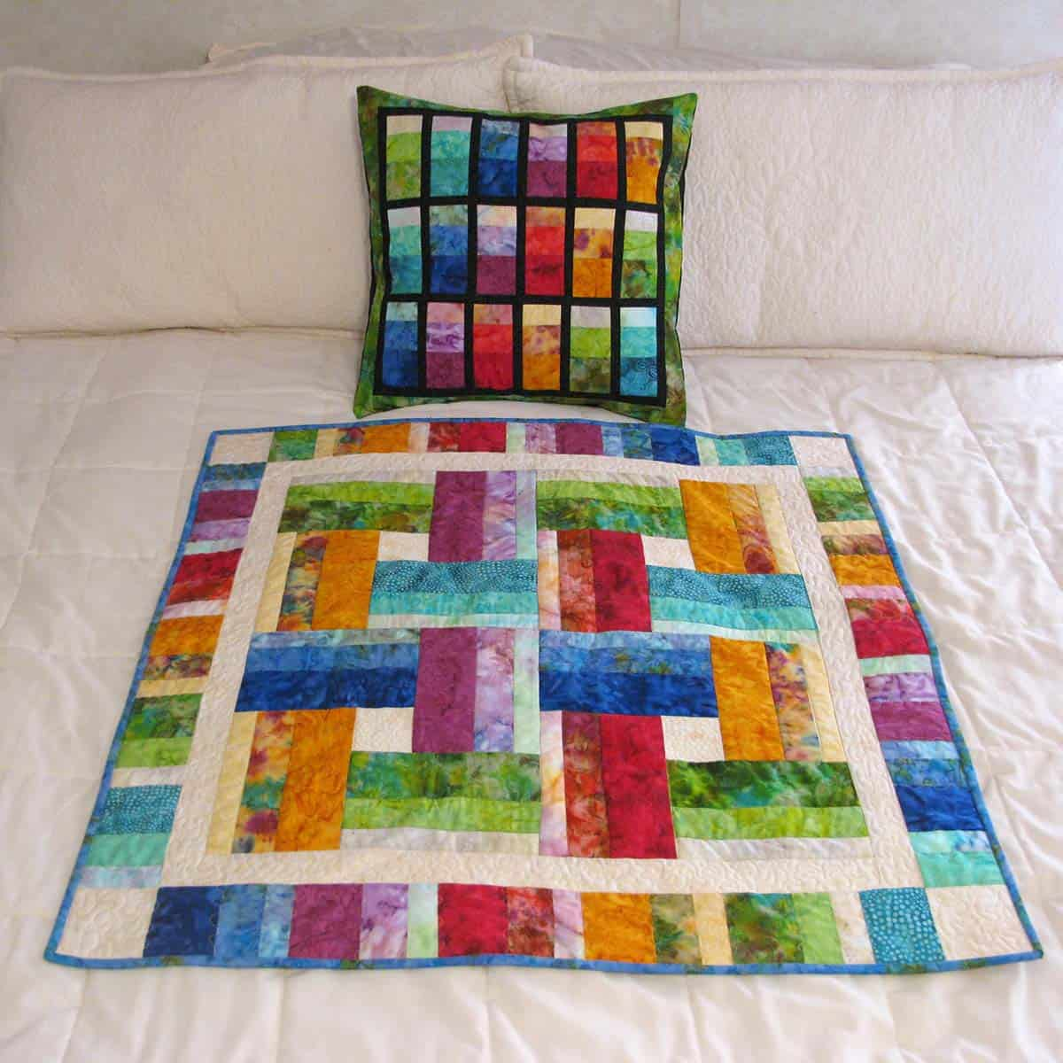 Stacked quilt and wall hanging from the batiks