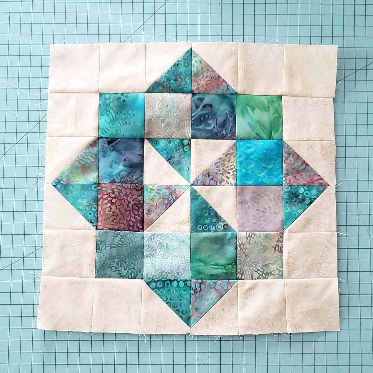 Teal pinwheel block